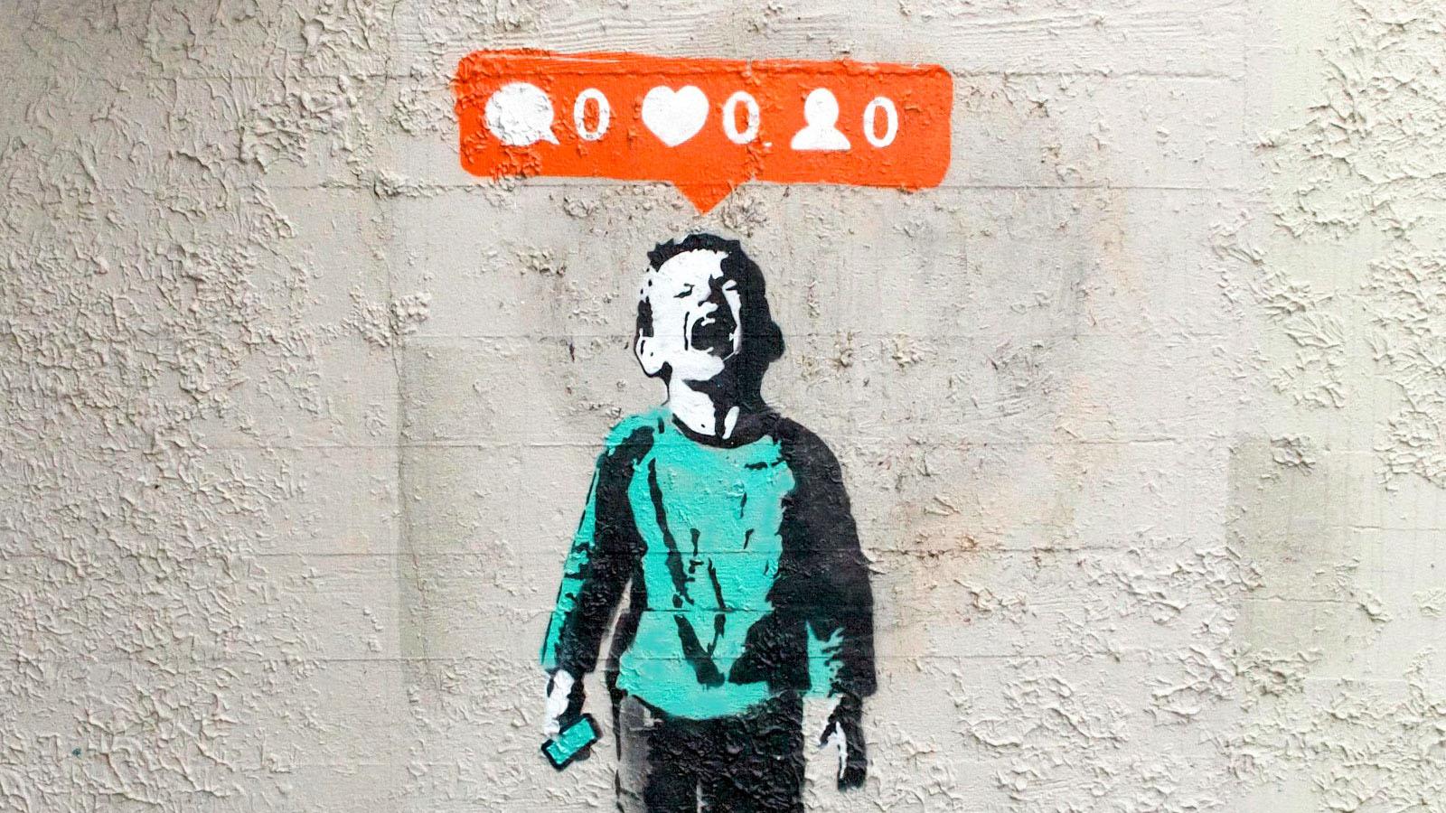 Valentinstag? Kannste vergessen! - Graffito eines weinenden Jungen mit Smartphone in der Hand