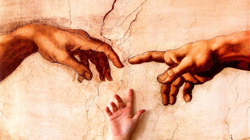 Gottvater schenkt Adam Leben und Geist - Feskenausschnitt der Erschaffung Adams von Michelangelo in der Sixtinischen Kapelle